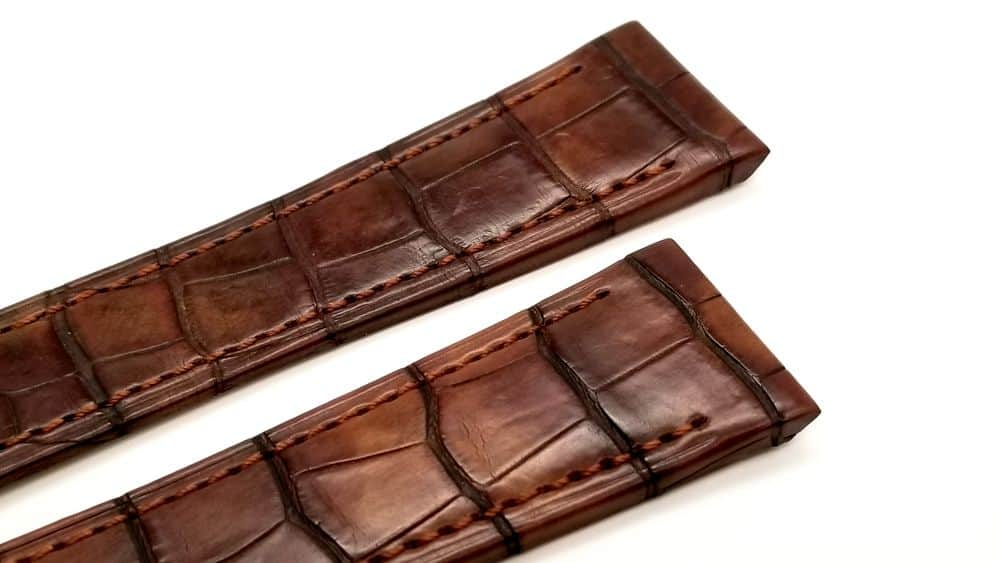 Genuine brown crocodile Selvaggio, featuring large scales